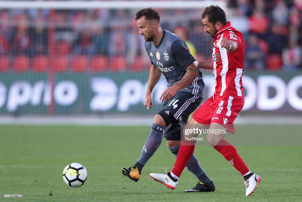 Benfica's Switzerland forward Haris Seferovic (L) with Aves´s player Gonzalo Santos (R) during the Premier League 2017/18 match between CD Aves and SL Benfica, at Estadio do Clube Desportivo das Aves in Aves on October 22, 2017.