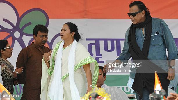 Bengal Chief Minister Mamta Banerjee and Bollywood actor Mithun Chakravorty during an election rally of Trinamool Congress at Morhabadi ground on...