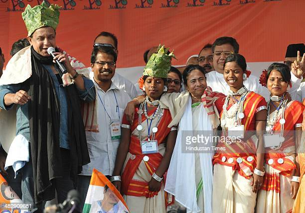 Bengal Chief Minister Mamta Banerjee and Bollywood actor Mithun Chakravorty wearing traditional tribal cap presented by tribal girls during an...