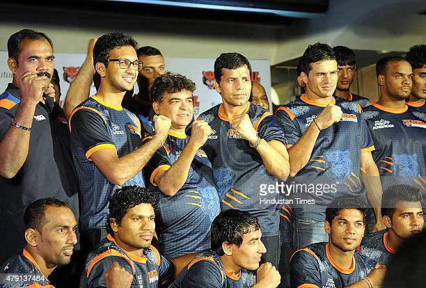 Bengal Warriors captain Dinesh Kumar with his team during a press meet for second edition of Pro Kabaddi league at a city hotel on July 1 2015 in...