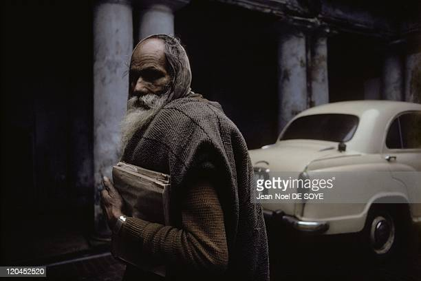Bengali aristocratic palace in Calcutta India in 1991 Bengali aristocrat holding the book traces the history of his family before an ambassador in...