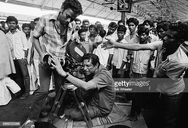 Bengali filmaker Satyajit Ray filming scenes of his movie 'Sonar Kella' in Calcutta