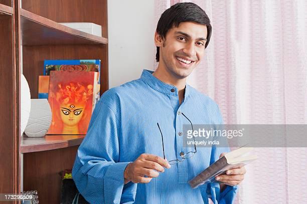 Bengali man holding a book