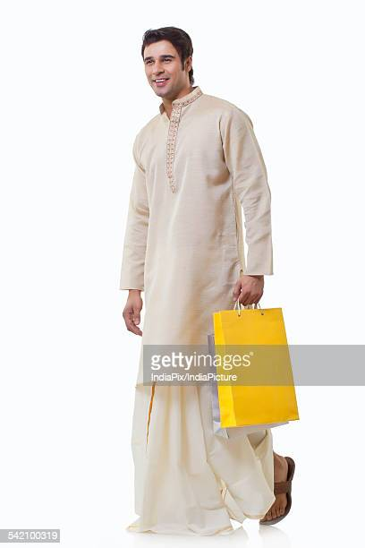 Bengali man holding shopping bags