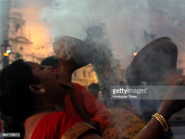 Bengali women performs traditional dance on ocassion of durga pooja at shivaji park