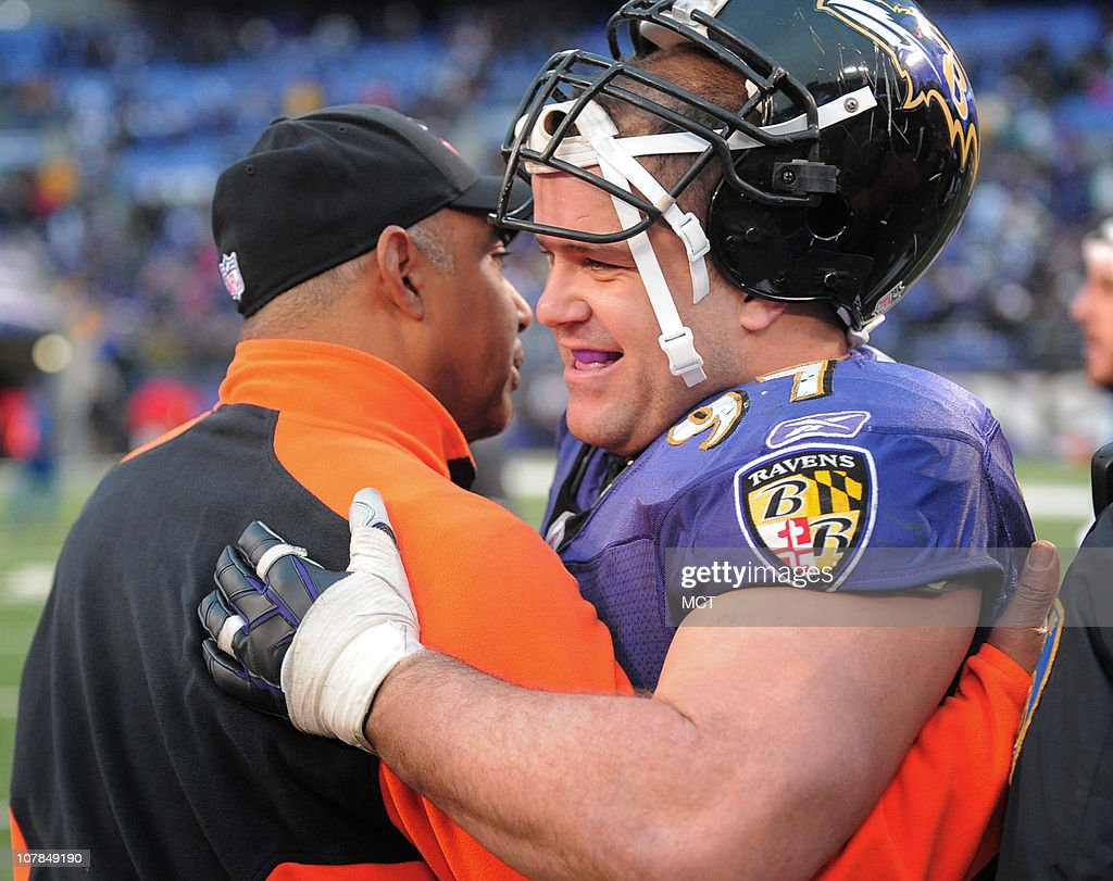 Bengals head coach Marvin Lewis greets one of his former players, Kelly Gregg after the Ravens defeat Cincinnati 13-7 on Sunday, January 2, 2011, at M&T Bank Stadium in Baltimore, Maryland.