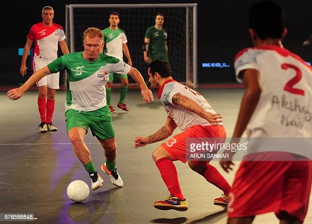 Bengaluru 5's Paul Scholes plays against the Kolkata 5's during their Premier Futsal Football League match in Chennai on July 16 2016 / AFP / ARUN...
