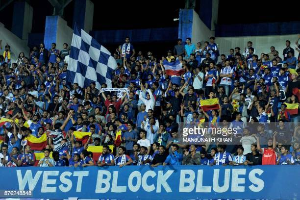 Bengaluru FC fans cheer during the Indian Super League football match against Mumbai City FC at Sree Kanteerava Stadium in Bangalore on November 19...
