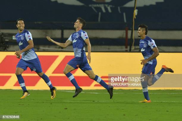 Bengaluru FC player Eduardo Garcia Martin celebrates with his teammates after scoring the first goal of the match against Mumbai City FC during their...