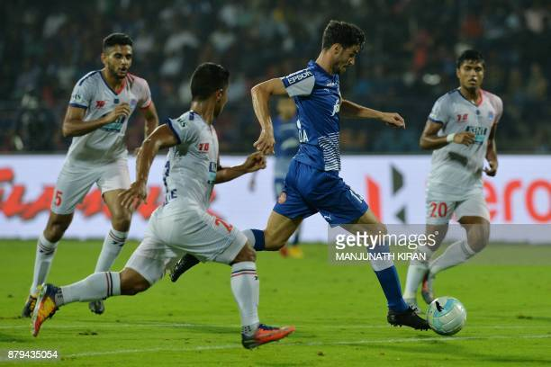 Bengaluru FC player Eduardo Garcia Martin runs the ball during the Indian Super League football match between Bengaluru FC and Delhi Dynamos at the...