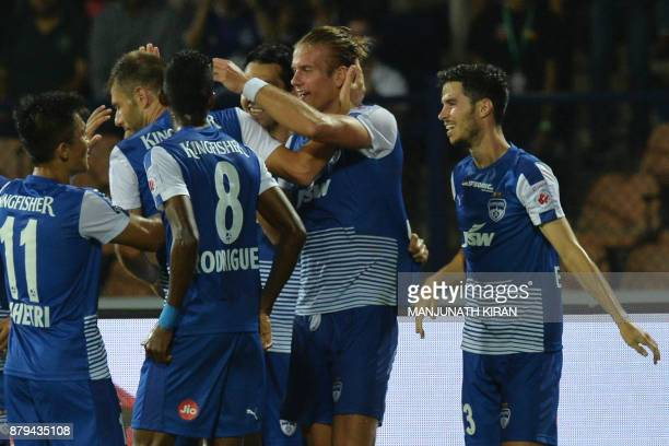 Bengaluru FC player Erik Endel Paartalu celebrates after scoring during the Indian Super League football match between Bengaluru FC and Delhi Dynamos...