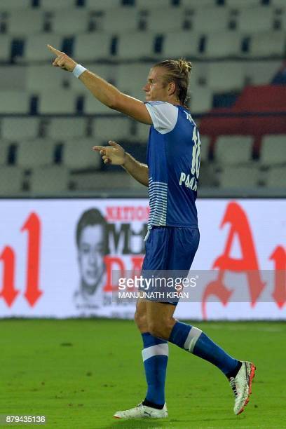 Bengaluru FC player Erik Endel Paartalu gestures to the crowd after scoring the first goal during the Indian Super League football match between...