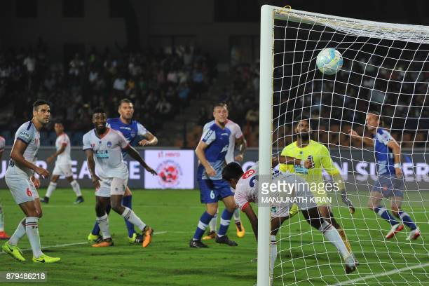 Bengaluru FC player Erik Endel Paartalu scores the second goal against Delhi Dynamos during the Indian Super League football match between Bengaluru...