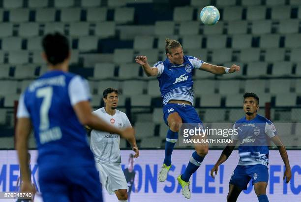 Bengaluru FC player Erik Endel Partalu heads the ball during the Indian Super League football match against Mumbai City FC at Sree Kanteerava Stadium...