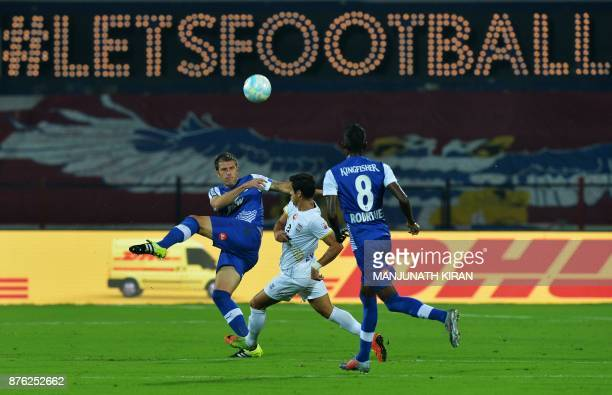Bengaluru FC player Juan Antonio Gonzalez Fernandez and Mumbai City FC player Everton Leandro Dos Santos Pinto fight for the ball during the Indian...