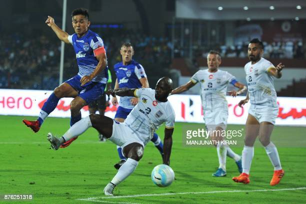 Bengaluru FC player Sunil Chhetri and Mumbai City FC player Achille Emana Edzimbi fight for the ball during their Indian Super League football match...