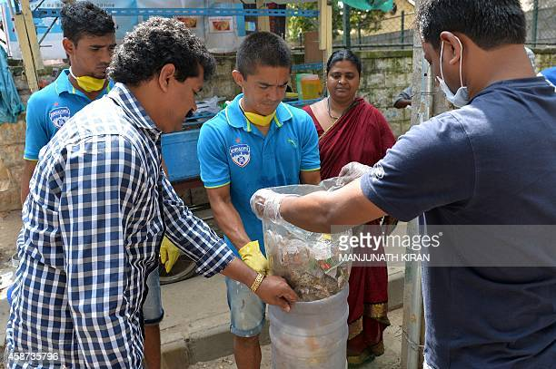 Bengaluru Football Club captain Sunil Chhetri and teammates collect waste as they clean in the neighbourhood of the football stadium in Bangalore on...