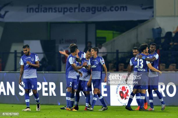 Bengaluru players celebrate their second goal during the Indian Super League football match between Bengaluru FC and Mumbai City FC at Sree...