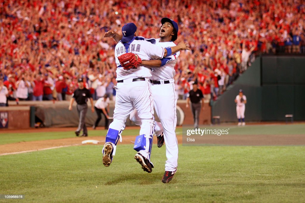 Bengie Molina #11 and Neftali Feliz #30 of the Texas Rangers celebrate after defeating the New York Yankees 6-1 in Game Six of the ALCS to advance to the World Series during the 2010 MLB Playoffs at Rangers Ballpark in Arlington on October 22, 2010 in Arlington, Texas.