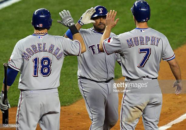 Bengie Molina of the Texas Rangers celebrates after hitting a threerun home run in the top of the sixth inning against AJ Burnett of the New York...