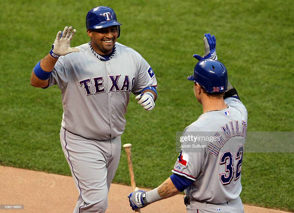 <a gi-track='captionPersonalityLinkClicked' href=/galleries/search?phrase=Bengie+Molina&family=editorial&specificpeople=167095 ng-click='$event.stopPropagation()'>Bengie Molina</a> #11 of the Texas Rangers celebrates with <a gi-track='captionPersonalityLinkClicked' href=/galleries/search?phrase=Josh+Hamilton&family=editorial&specificpeople=234355 ng-click='$event.stopPropagation()'>Josh Hamilton</a> #32 after scoring in the second inning against the San Francisco Giants in Game One of the 2010 MLB World Series at AT&T Park on October 27, 2010 in San Francisco, California.