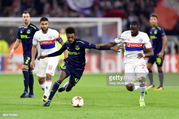 Beni Baningime of Everton and Tanguy NDombele challenge for the ball during the UEFA Europa League match between Olympique Lyon and Everton at...