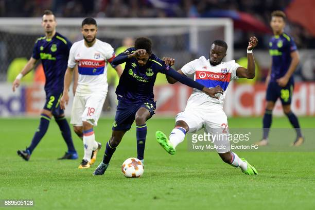 Beni Baningime of Everton and Tanguy NDombele challenge the ball during the UEFA Europa League match between Olympique Lyon and Everton at Groupama...