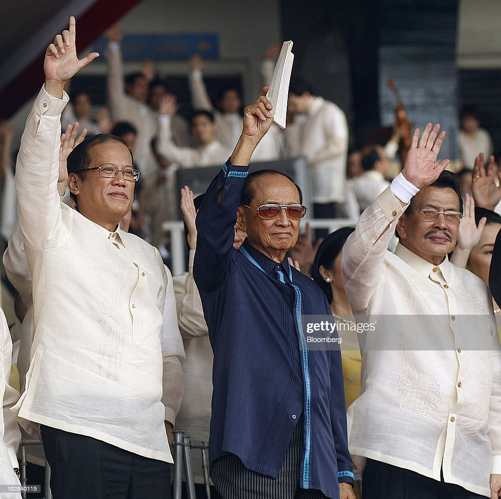Benigno Aquino, Philippine president, left, stands with <a gi-track='captionPersonalityLinkClicked' href=/galleries/search?phrase=Fidel+Ramos&family=editorial&specificpeople=214045 ng-click='$event.stopPropagation()'>Fidel Ramos</a>, center, and <a gi-track='captionPersonalityLinkClicked' href=/galleries/search?phrase=Joseph+Estrada&family=editorial&specificpeople=553277 ng-click='$event.stopPropagation()'>Joseph Estrada</a>, both former presidents of the Philippines, during his inauguration at Quirino Grandstand in Manila, the Philippines, on Wednesday, June 30, 2010. Aquino, who rose from political outsider to Philippine president in less than a year, takes office today pledging to fight poverty, narrow the budget deficit and refrain from raising taxes in a nation trailing its neighbors in economic growth and international investment. Photographer: Edwin Tuyay/Bloomberg via Getty Images