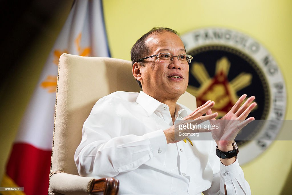 Benigno Aquino, the Philippines' president, gestures as he speaks during an interview in the Malacanang Palace compound in Manila, the Philippines, on Wednesday, May 8, 2013. The Philippines, Asia's fastest-growing economy after China, needs to do more to finally lose its decades-old tag as the 'Sick Man of Asia,' according to Aquino. Photographer: Julian Abram Wainwright/Bloomberg via Getty Images