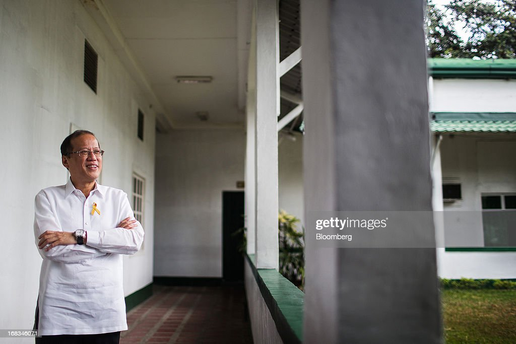 Benigno Aquino, the Philippines' president, poses for a photograph in the Malacanang Palace compound in Manila, the Philippines, on Wednesday, May 8, 2013. The Philippines, Asia's fastest-growing economy after China, needs to do more to finally lose its decades-old tag as the 'Sick Man of Asia,' according to Aquino. Photographer: Julian Abram Wainwright/Bloomberg via Getty Images