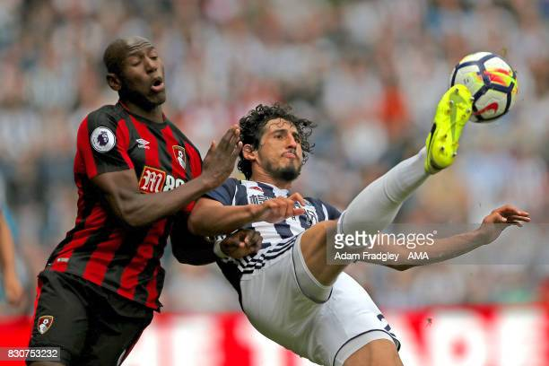 Benik Afobe of AFC Bournemouth and Ahmed Hegazi of West Bromwich Albion during the Premier League match between West Bromwich Albion and AFC...
