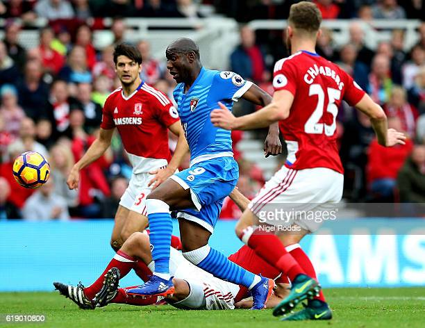 Benik Afobe of AFC Bournemouth and Ben Gibson of Middlesbrough compete for the ball during the Premier League match between Middlesbrough and AFC...