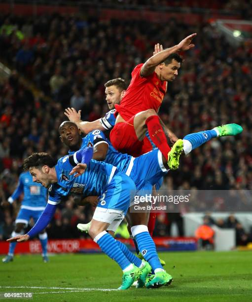 Benik Afobe of AFC Bournemouth and Dejan Lovren of Liverpool battle to win a header during the Premier League match between Liverpool and AFC...