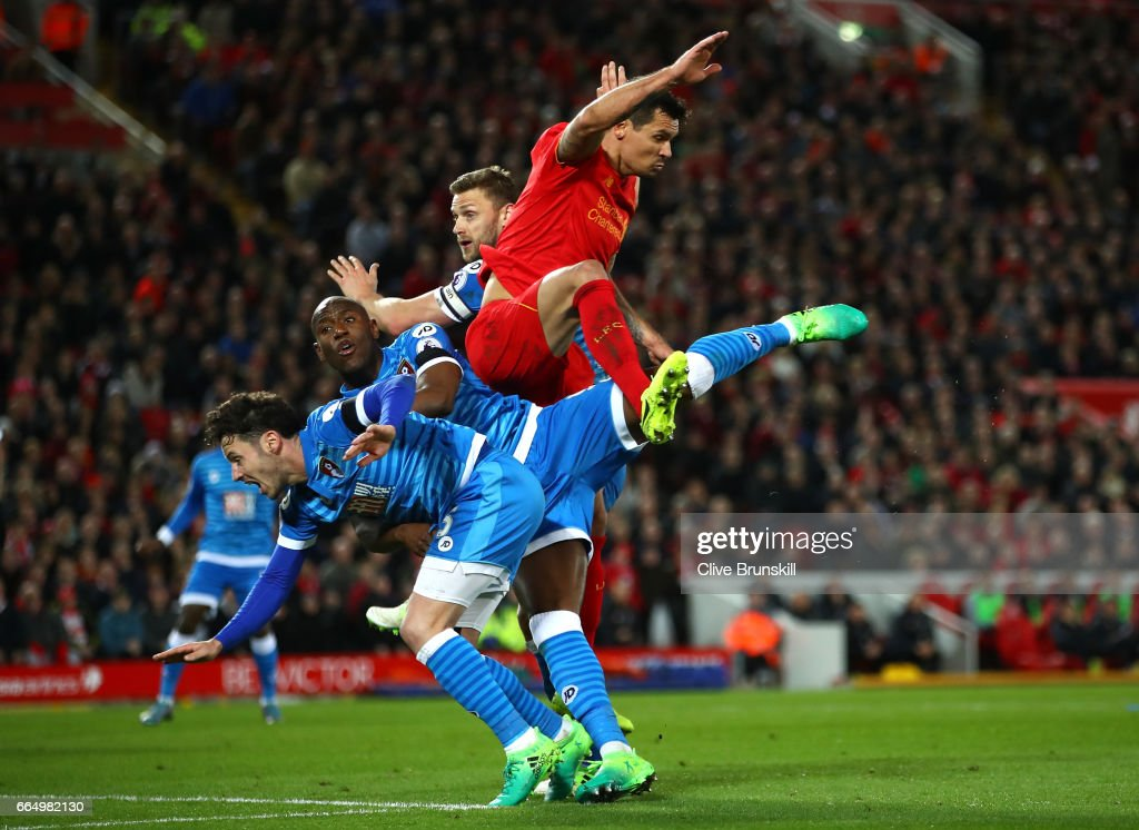 Benik Afobe of AFC Bournemouth and Dejan Lovren of Liverpool battle to win a header during the Premier League match between Liverpool and AFC Bournemouth at Anfield on April 5, 2017 in Liverpool, England.