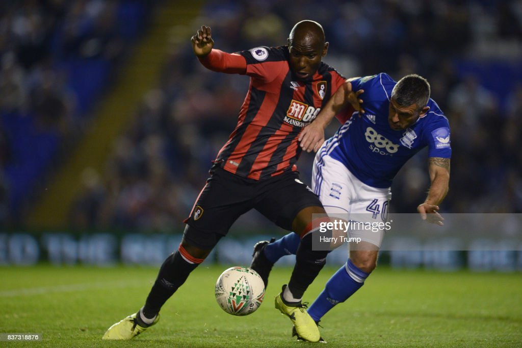 Benik Afobe of AFC Bournemouth and Paul Robinson of Birmingham City battle for possession during the Carabao Cup Second Round match between Birmingham City and AFC Bournemouth at St Andrews (stadium) on August 22, 2017 in Birmingham, England.