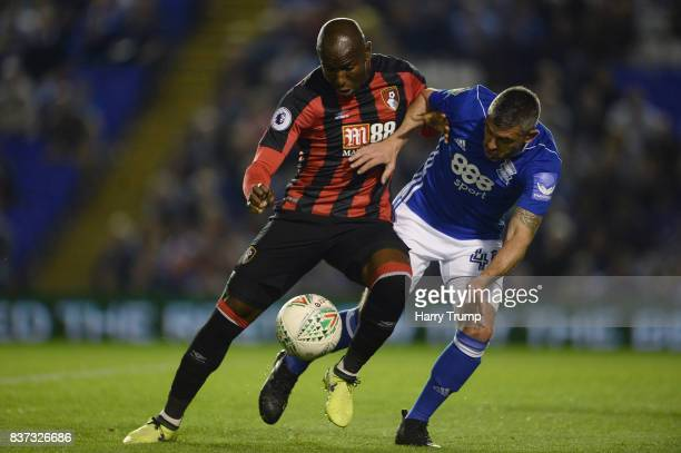 Benik Afobe of AFC Bournemouth and Paul Robinson of Birmingham City battle for possession during the Carabao Cup Second Round match between...