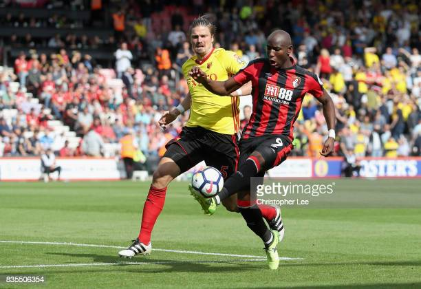 Benik Afobe of AFC Bournemouth and Sebastian Prodl of Watford battle for possession during the Premier League match between AFC Bournemouth and...