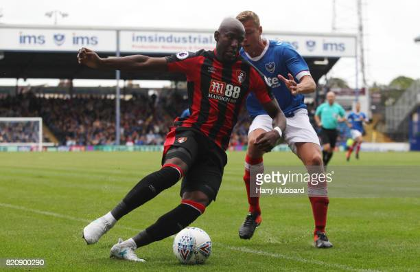 Benik Afobe of AFC Bournemouth and Tom Davies of Portsmouth in action during a preseason friendly match between Portsmouth and AFC Bournemouth at...