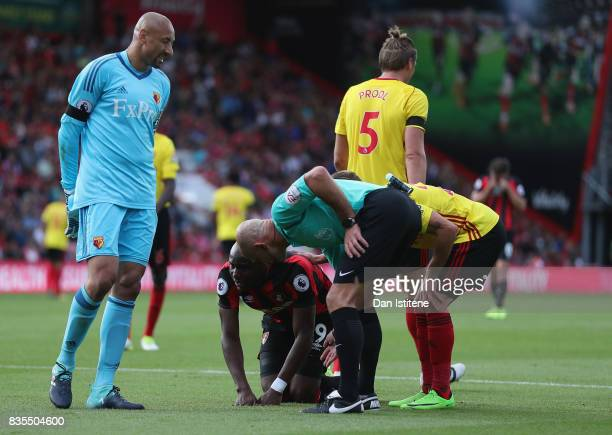 Benik Afobe of AFC Bournemouth is spoken to by Referee Roger East after he goes down injured during the Premier League match between AFC Bournemouth...