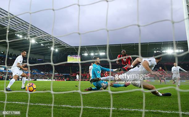 Benik Afobe of AFC Bournemouth scores the opening goal during the Premier League match between Swansea City and AFC Bournemouth at Liberty Stadium on...