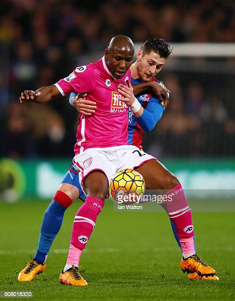 Benik Afobe of Bournemouth and Joel Ward of Crystal Palace compete for the ball during the Barclays Premier League match between Crystal Palace and...