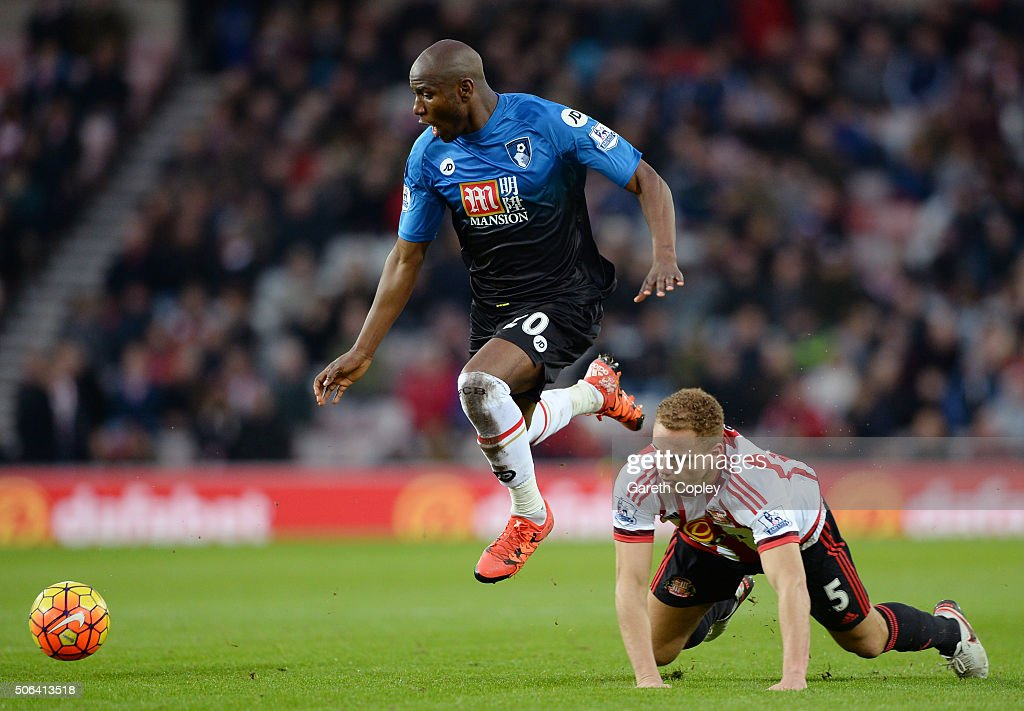 Benik Afobe of Bournemouth and Wes Brown of Sunderland compete for the ball during the Barclays Premier League match between Sunderland and A.F.C. Bournemouth at the Stadium of Light on January 23, 2016 in Sunderland, England.