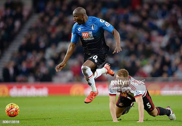 Benik Afobe of Bournemouth and Wes Brown of Sunderland compete for the ball during the Barclays Premier League match between Sunderland and AFC...
