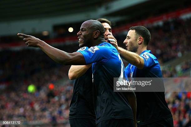 Benik Afobe of Bournemouth celebrates scoring his team's first goal with his team mates during the Barclays Premier League match between Sunderland...