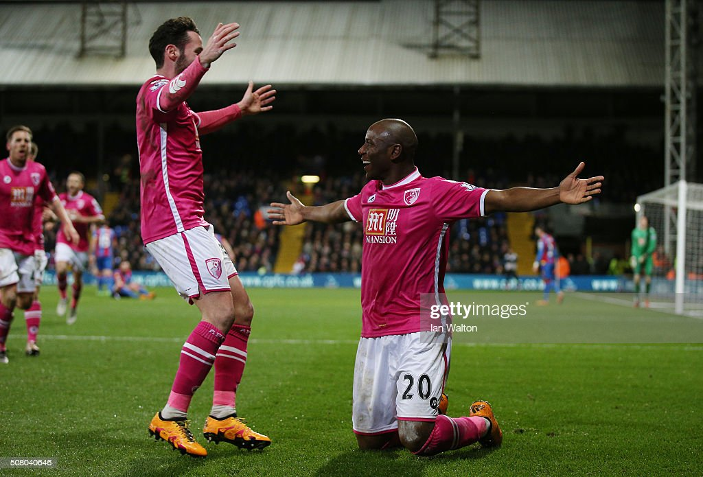 Benik Afobe (R) of Bournemouth celebrates scoring his team's second goal during the Barclays Premier League match between Crystal Palace and A.F.C. Bournemouth at Selhurst Park on February 2, 2016 in London, England.