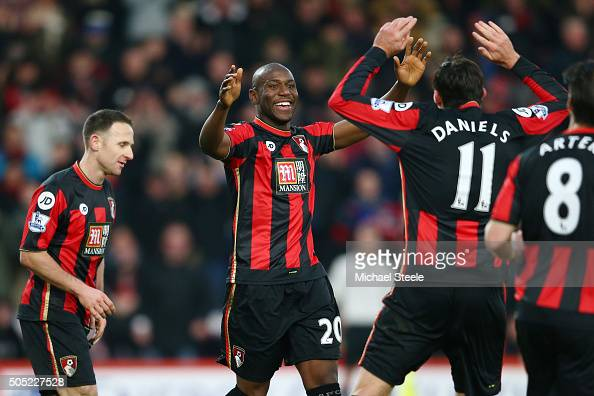 Benik Afobe of Bournemouth celebrates scoring his team's third goal with his team mate Charlie Daniels during the Barclays Premier League match...