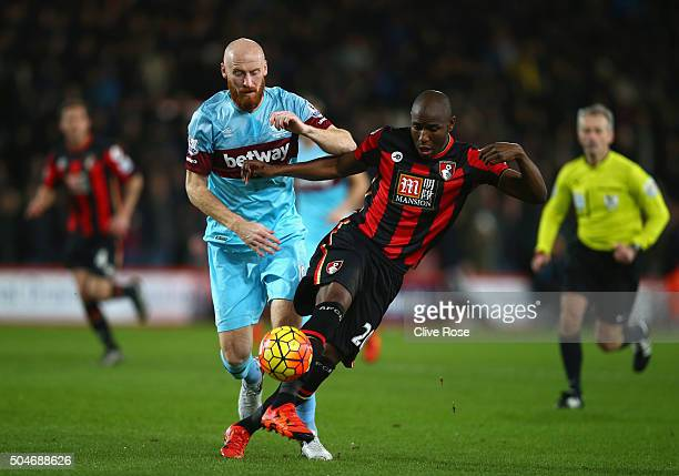 Benik Afobe of Bournemouth evades James Collins of West Ham United during the Barclays Premier League match between AFC Bournemouth and West Ham...