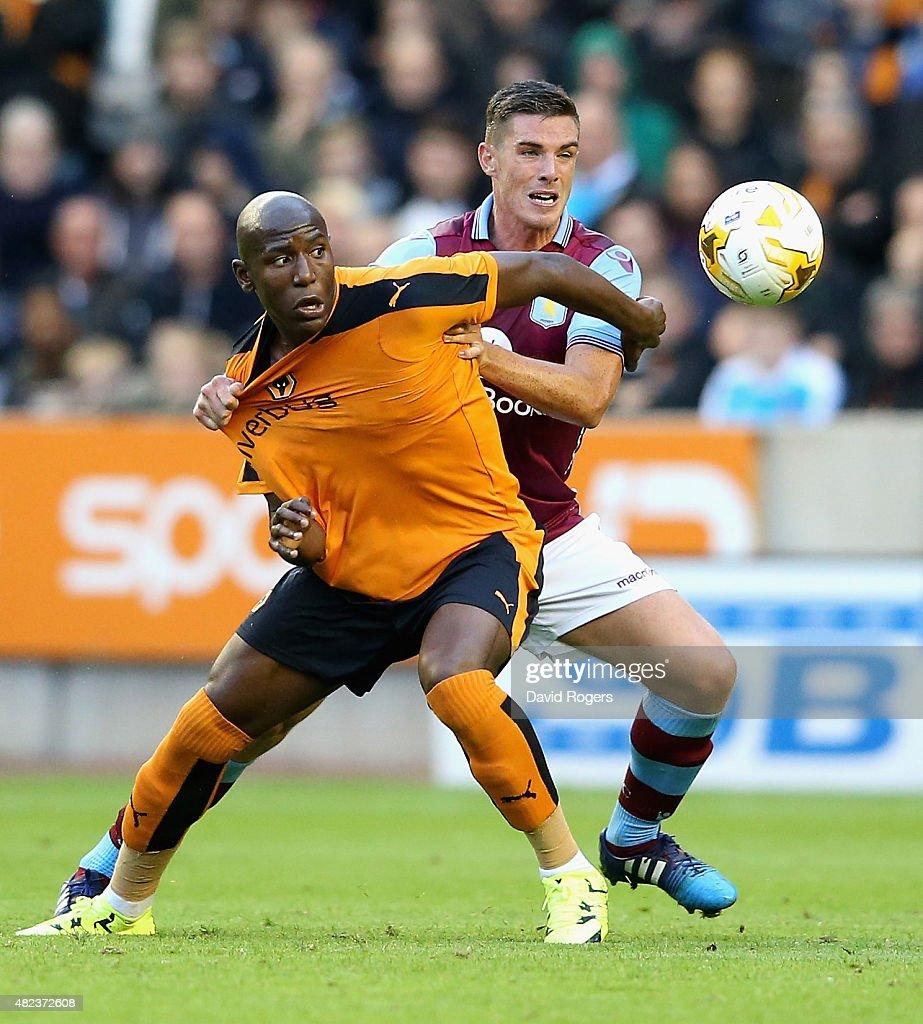 Benik Afobe of Wolverhampton Wanderers is challenged by Ciaran Clark during the pre season friendly between Wolverhampton Wanderers and Aston Villa...