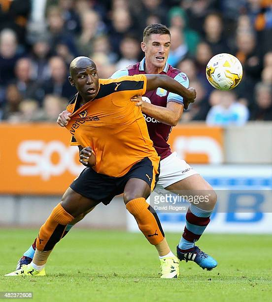 Benik Afobe of Wolverhampton Wanderers is challenged by Ciaran Clark during the pre season friendly between Wolverhampton Wanderers and Aston Villa...