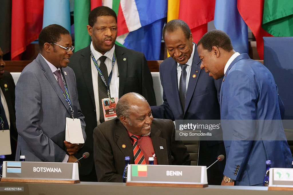 Benin President Boni Yayi (R) and Burkina Faso President Blaise Copaore (2nd R) visit with Botswana Foreign Minister PhAndu Tombola Chanda Skelemani (seated) before the first plenary session of the U.S.-Africa Leaders Summit at the State Department August 6, 2014 in Washington, DC. U.S. President Obama hosted last day of the first-ever summit to strengthen ties between the United States and African nations.